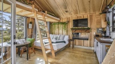 rustic interior of wooden treehouse cabin