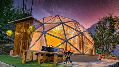 Glass dome overlooking purple and pink sunset views